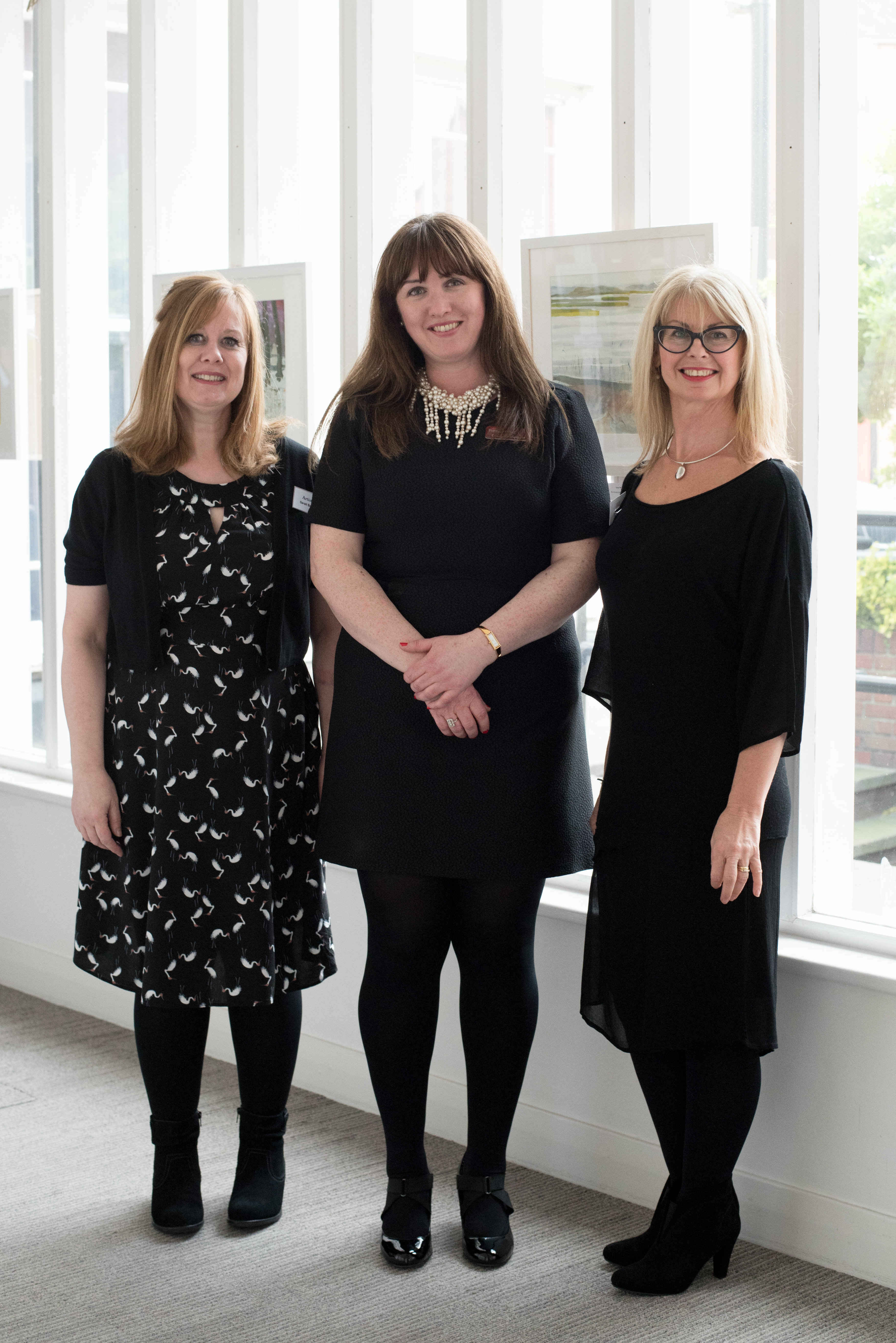 Exhibition curators Sarah Bale and Julie Dodds with organiser Georgina Rayment from Prettys